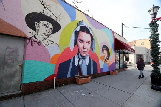 A mural of the Palmer family, one of the first families to settle in the Village of Larchmont, photographed Jan. 16, 2019,  was painted on the wall outside the Corner Store in Larchmont in late 2018. The Village of Mamaroneck is exploring the possibility of having similar types of murals painted on blank walls throughout the village.