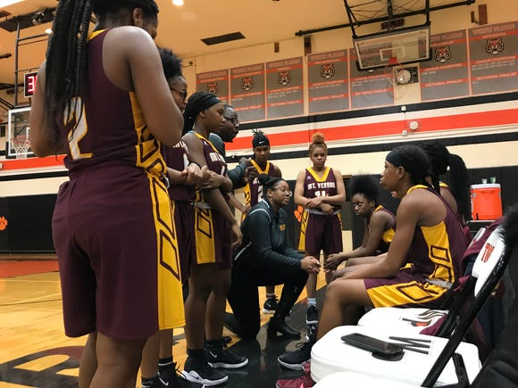 Mount Vernon head coach Erica Naughton talks to her team during a timeout in a game at White Plains. Jan. 15, 2019.