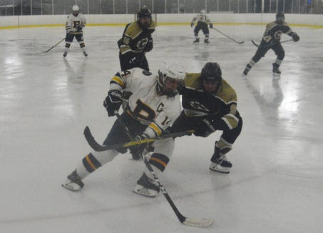 Pelham defenseman Connor Evans attempts to turn toward the net during a 7-1 win over Clarkstown on Tuesday, Jan. 15, 2019 at the Ice Hutch in Mount Vernon.