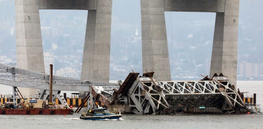 A boat travels passed the Tappan Zee Bridge in the Hudson River, a day after it was imploded, as seen from Tarrytown Jan. 16, 2019.