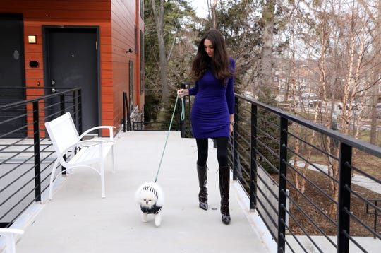 "Kris Ruby walks her three-year-old teacup Pomeranian, Caicos, who dons his Henri Bendel coat, Jan. 10, 2019 near her home in White Plains. Ruby, 32, describes Caicos as the ""love of her life"" and gives him the very best treatment in everything from gourmet pet food to personalized accessories."