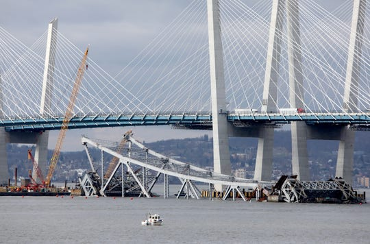 Cranes at work beside the Tappan Zee Bridge in the Hudson River, a day after it was imploded, as seen from Tarrytown Jan. 16, 2019.