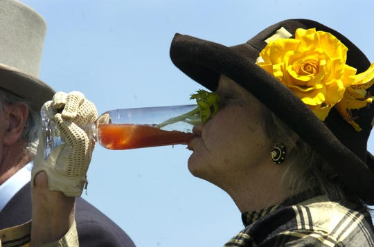 In this 2006 photo, Phyllis Wyeth has a cool drink atop a carriage at Winterthur Museum's annual Point-to-Point steeplechase races.