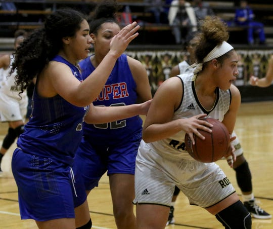 Rider's Addison Self dribbles while guarded by Abilene Cooper defenders Tuesday, Jan. 15, 2019, at Rider.