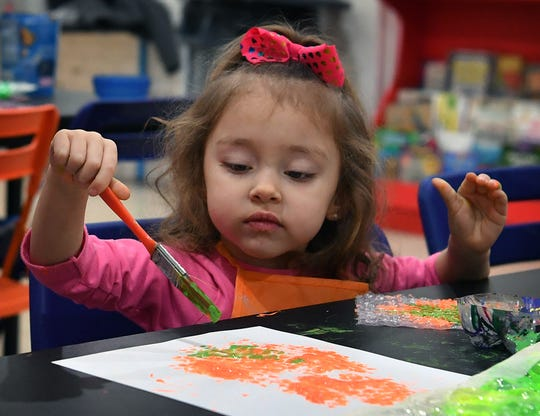 In this file photo, 3-year-old Zoe Chavez paints during an art experience using bubblewrap at CrashWork STEAM Studio & Makerspace.