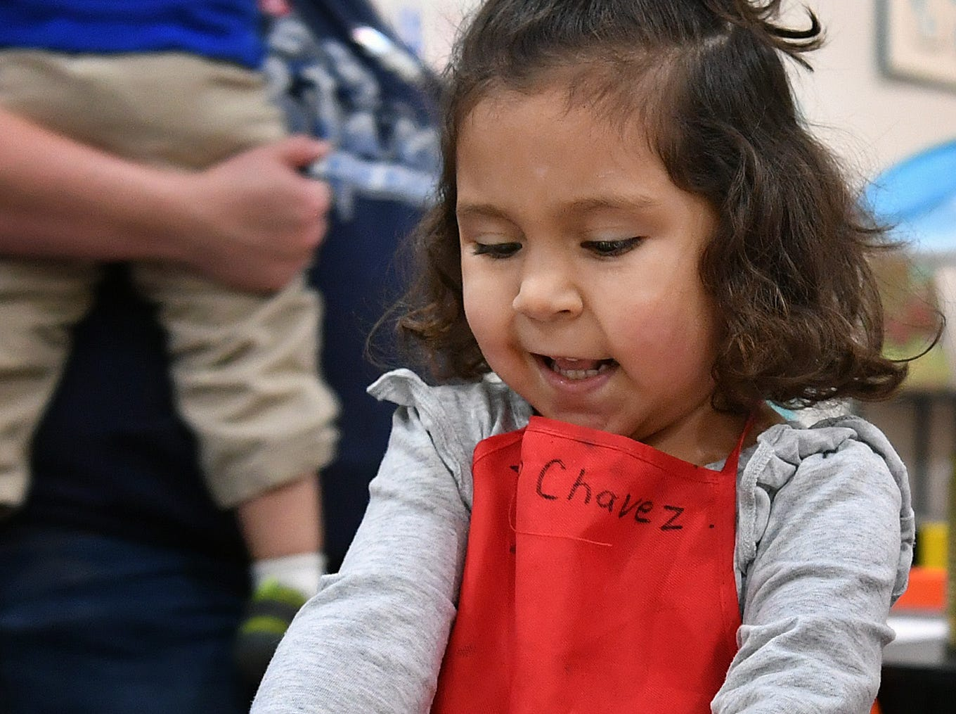 Zoe Chavez squeezes a bubblewrap envelope of paint while playing at CrashWorks STEAM Studio & Makerspace. Each Wednesday features a different Mommy and Me event for kids from newborn to 5 years-old.