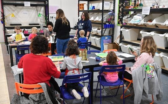 Children and parents participate in a Mommy and Me activity Wednesday morning at CrashWorks STEAM Studio & Makerspace.  The art and sensory exercise involved paint and bubblewrap.