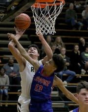 Rider's Jacob Rodriguez lays the ball in against Abilene Cooper Tuesday, Jan. 15, 2019, at Rider.