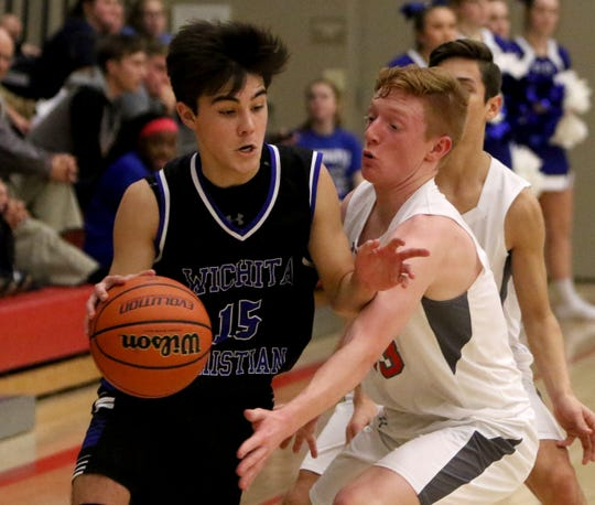 Wichita Christian's Parker Landes dribbles by Christ Academy's Grayson Southard Tuesday, Jan. 15, 2019, at Christ Academy.