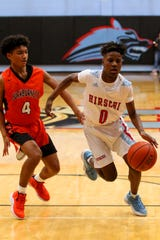 Hirschi's Ernest Young dribbles around Burkburnett's Jaevion Moreland Tuesday at Hirschi Fieldhouse.