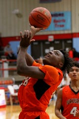 Burkburnett's Kendarius Horton takes the shot Tuesday at HIrschi Fieldhouse.