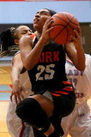 Burkburnett's Eternity Jackson goes up against two Hirschi defenders Friday at Hirschi Fieldhouse.