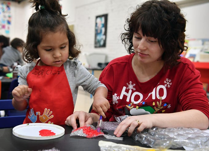 Zoe Chavez, 3, and her mother, Tiffany Chavez, apply paint to bubblewrap during a Mommy and Me art program Wednesday at CrashWorks STEAM Studio & Makerspace.
