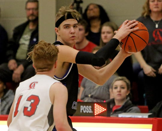 Wichita Christian's Griffin Messer looks to pass while guarded by Christ Academy's Grayson Southard Tuesday, Jan. 15, 2019, at Christ Academy.