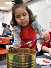 Zoe Chavez, 3, rinses her paint brush during a Mommy and Me event at CrashWorks STEAM Studio & Makerspace Wednesday. The event provided a unique sensory experience with paint and bubblewrap.