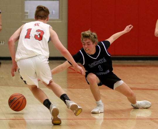 Wichita Christian's Dalyn Miller (1) and Christ Academy's Grayson Southard (13) go for the loose ball last week in a district game.