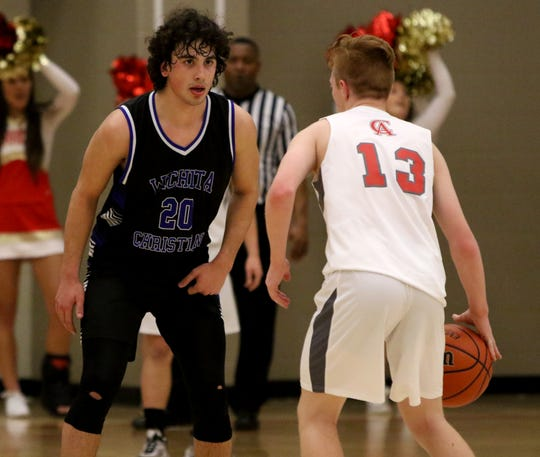 Wichita Christian's Evan Findley guards Christ Academy's Grayson Southard Tuesday, Jan. 15, 2019, at Christ Academy.