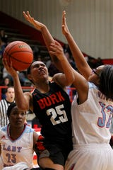 Burkburnett's Eternity Jackson is fouled by Hirschi's Alexius Hampton at Hirschi Fieldhouse on Friday.