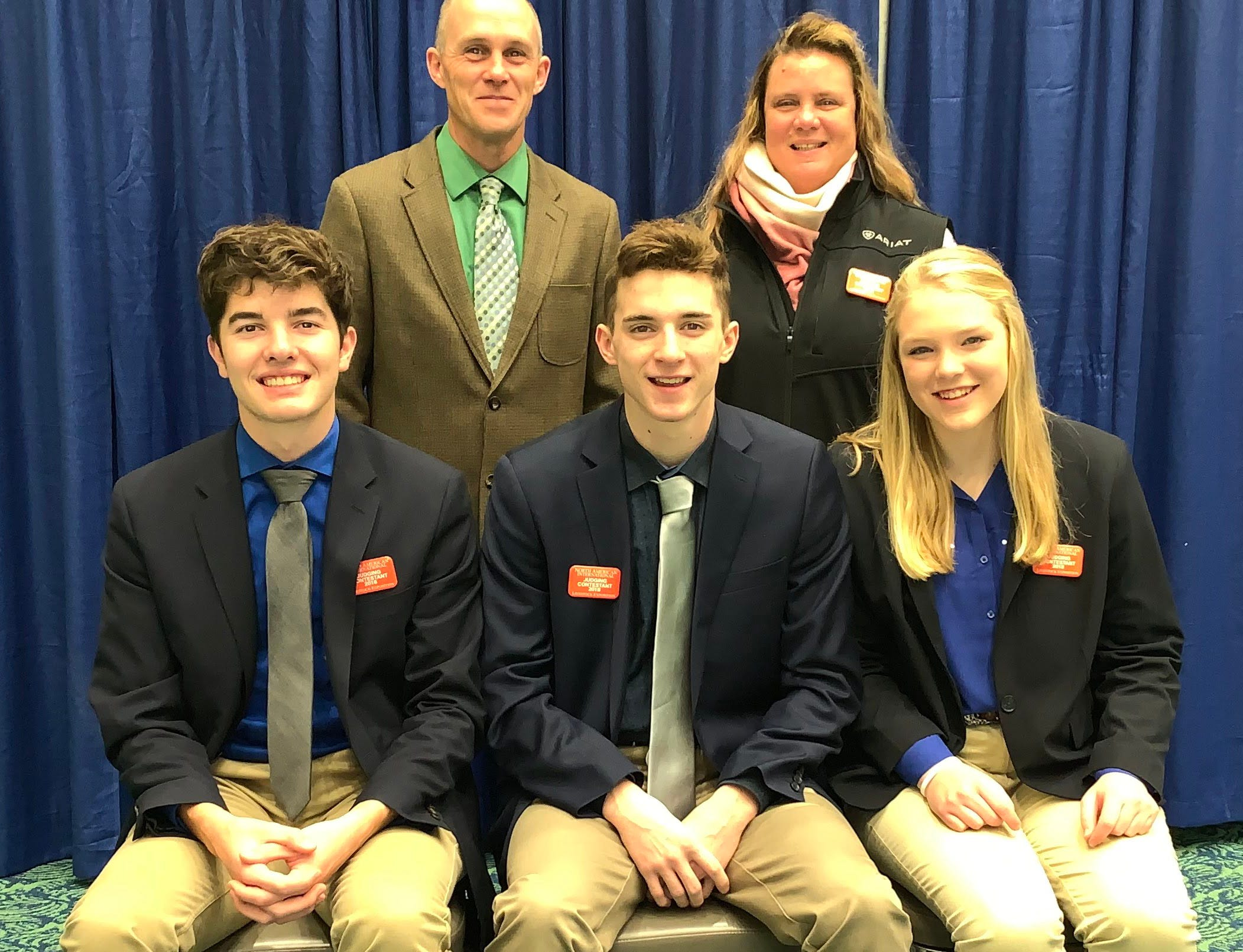 Iowa County 4-H Livestock Judging team is comprised of (from left) Brady Palzkill, Brandon Spring and Morgan Vondra. Coaches for the team are (back row from left) Mike Robinson and Lora Springer.