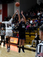 Cobe Curry fires a 3 over Jett Joseph during visiting Zanesville's 44-41 loss to New Philadelphia on Tuesday night. Curry posted game highs of 17 points and six rebounds.
