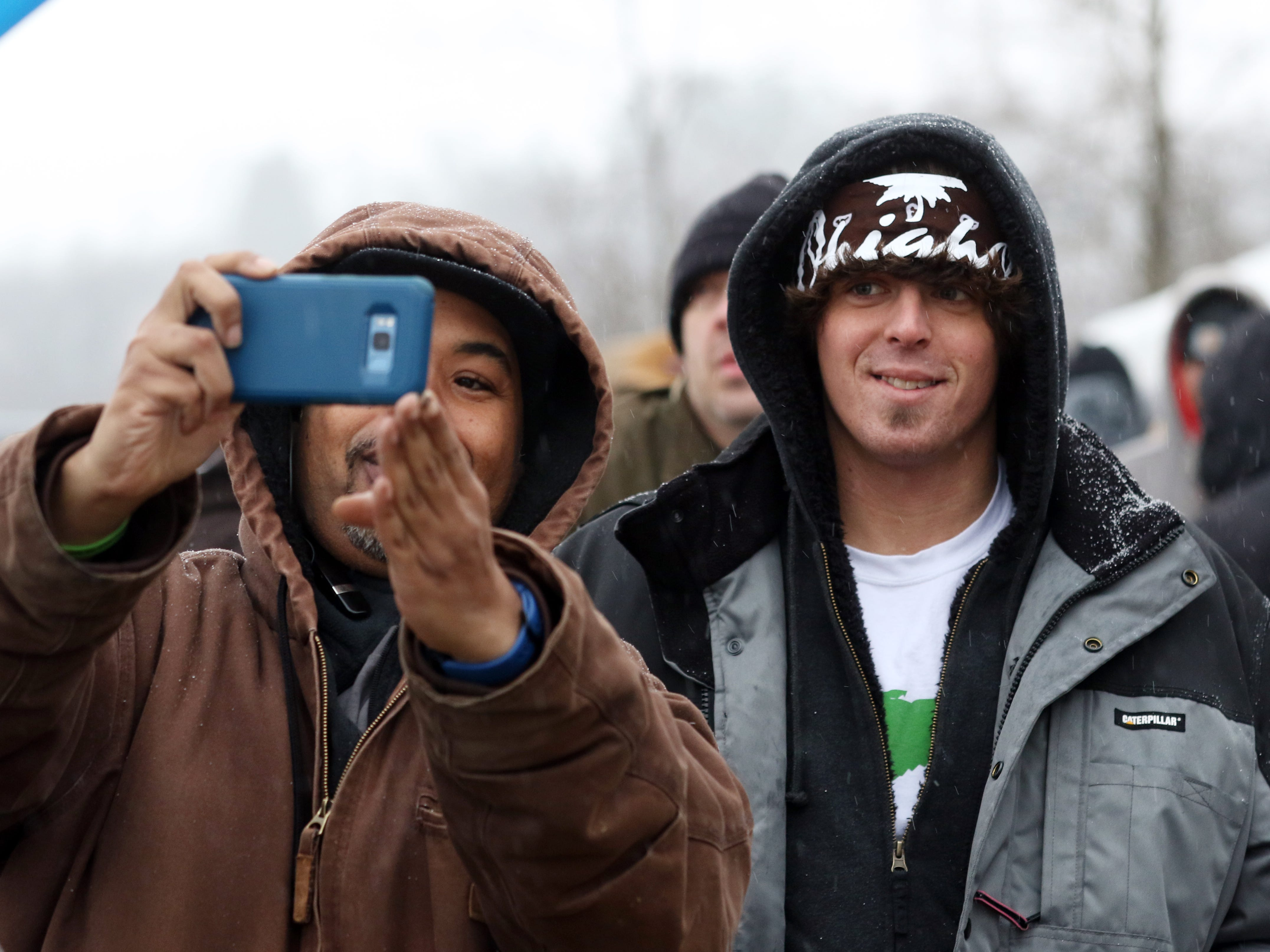 Anthony Riley, left, of Columbus, takes a selfie with Sterling Strout of Dayton while waiting in line outside CY+ Wintersville Dispensary on Wednesday. The dispensary was one of the first in the state to sell medical marijuana.