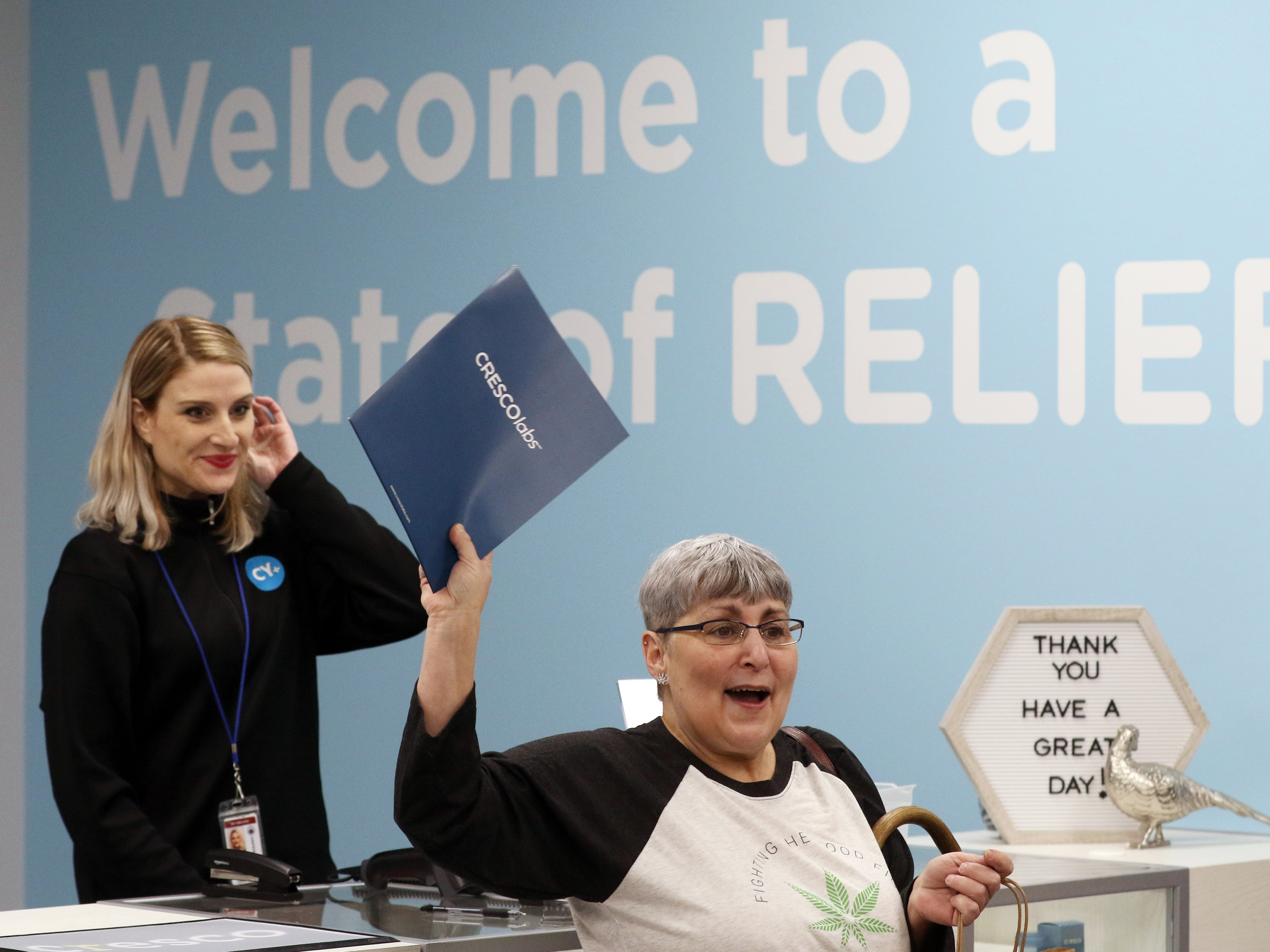Joan Caleodis of Martins Ferry celebrates after becoming the first person to purchase medical marijuana at CY+ Dispensary in Wintersville Wednesday morning.