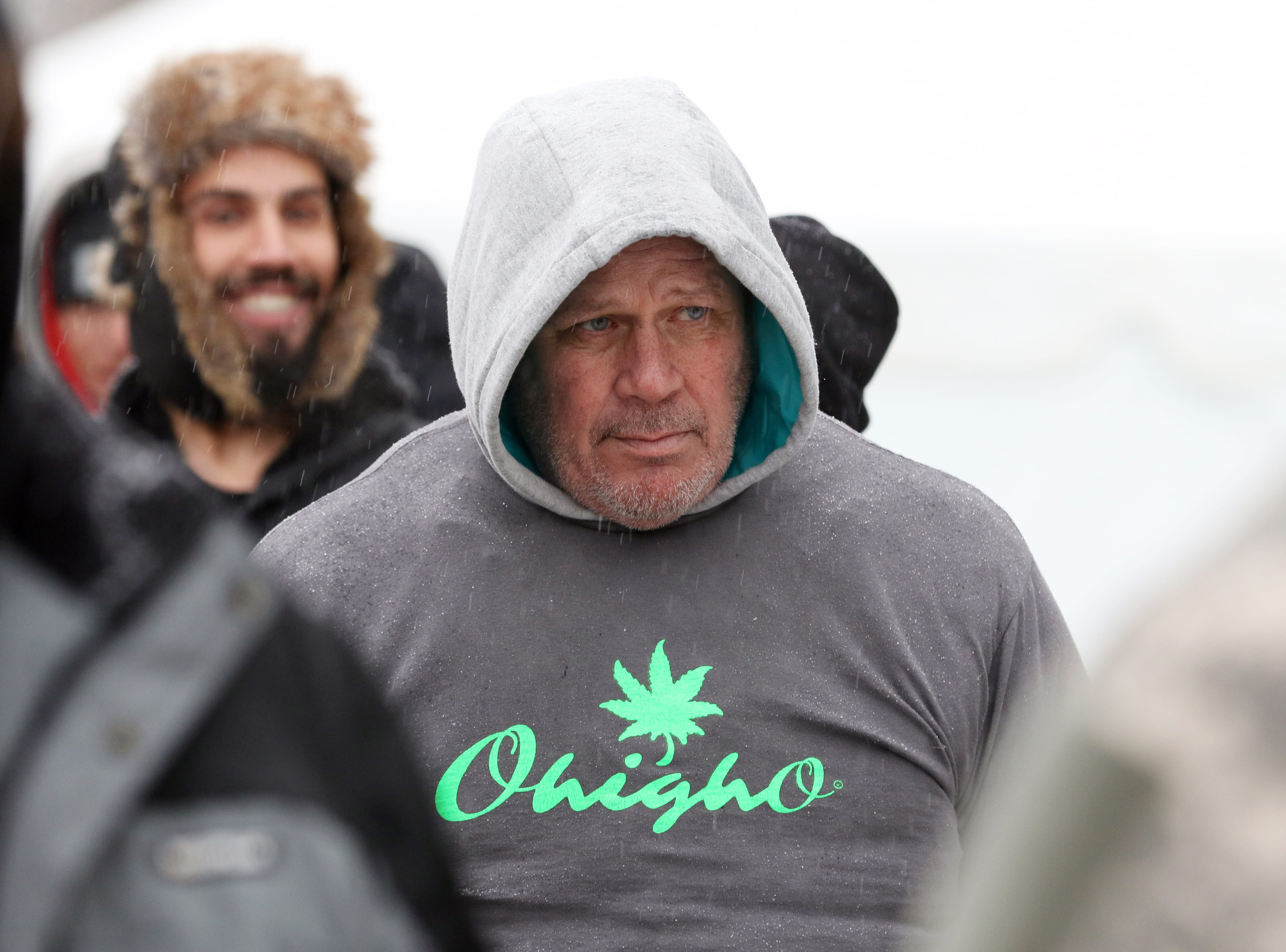 Dave Williams of Columbus waits in line outside the CY+ Wintersville Dispensary on Wednesday.