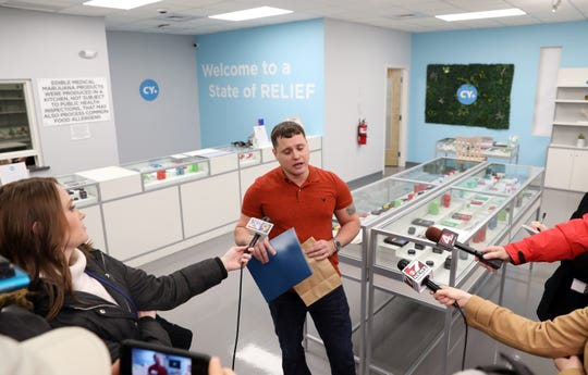 Alex Griffith of Cincinnati speaks to the media after purchasing medical marijuana at the CY+ Dispensary in Wintersville on Wednesday.