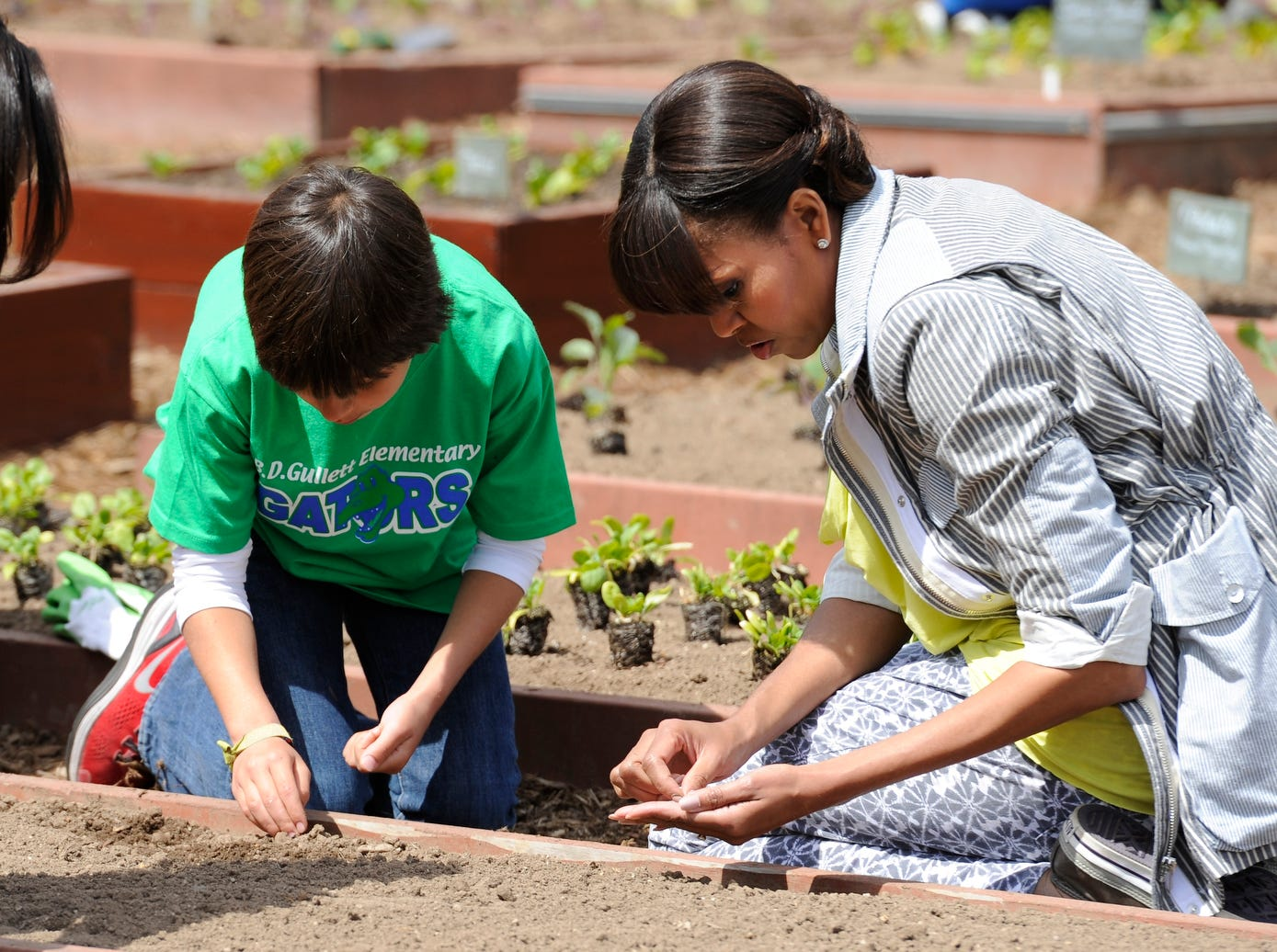 4/4/13 1:27:41 PM -- Washington, DC, U.S.A  -- First Lady Michelle Obama plants the White House garden with Emilio Vega from Benjamin D. Gullett Elementary School in Bradenton, Fla.   Photo by H. Darr Beiser, USA TODAY staff  ORG XMIT: HB 43251 VT WHITE HOUSE G 4/4/20 (Via OlyDrop)