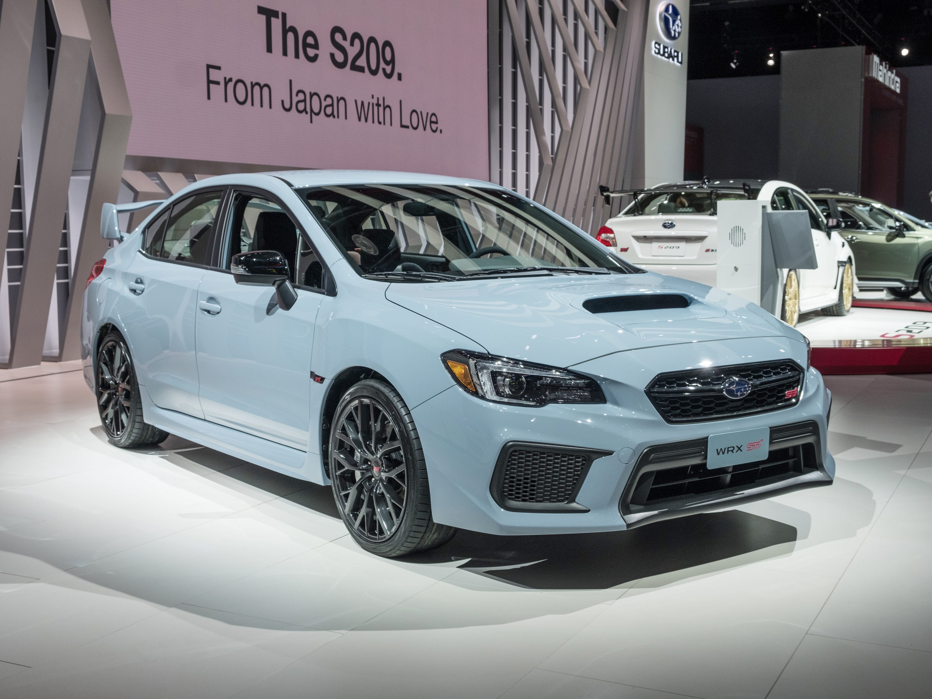 A 2019 Subaru WRX STi sits on the stage during the 2019 North American International Auto Show held at Cobo Center in downtown Detroit on Tuesday, Jan. 15, 2019.  (Via OlyDrop)
