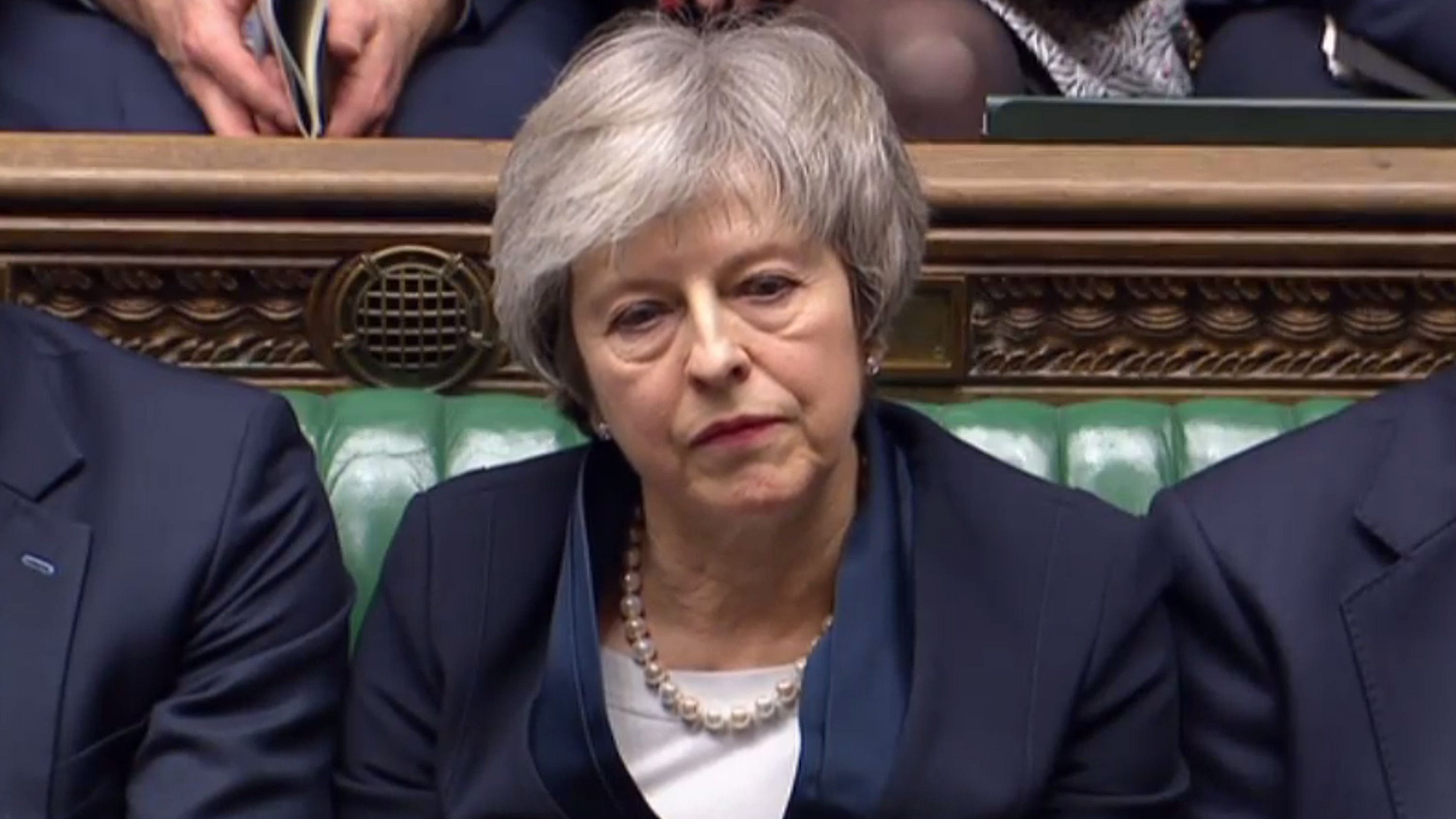 Britain's Prime Minister Theresa May reacts in Parliament on Jan. 15, 2019, as opposition Labour Party leader Jeremy Corbyn informs lawmakers he tabled a vote of no confidence in her government.
