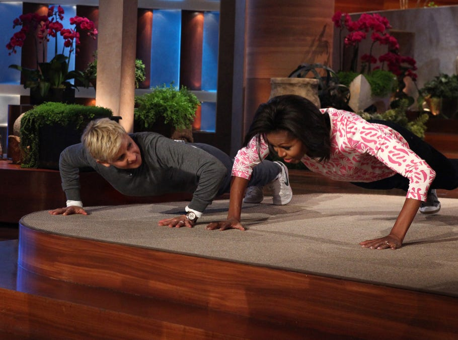 """ANY AP HANDOUT PHOTO OVER 30 DAYS OLD MUST BE CHECKED AGAINST AP ARCHIVE FOR USAGE RIGHTS. DO NOT PUBLISH WITHOUT PHOTO EDITOR CONFIRMATION. ORG XMIT: NYET410 In this photo released by Warner Bros, talk show host Ellen DeGeneres challenges First Lady Michelle Obama to a push up contest during a taping of """"The Ellen DeGeneres Show"""" in Burbank, Calif., on Wednesday, Feb. 1, 2012.  This episode aired on Thursday, Feb. 2. (AP Photo/Warner Bros., Michael Rozman)"""