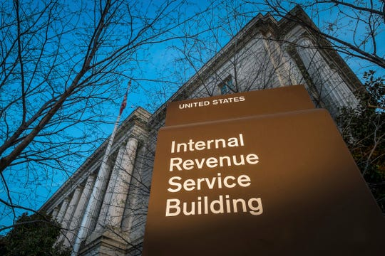 This 2014 file photo shows the headquarters of the Internal Revenue Service (IRS) in Washington. The IRS plans to bring back 36,000 furloughed workers during the week of Jan 14, 2019, to prepare for tax filing season.