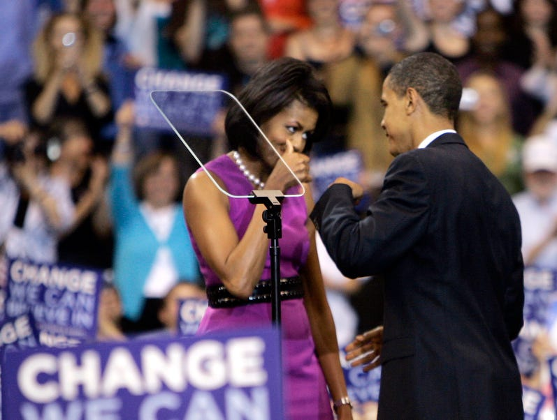 ORG XMIT: BX601 FILE - This June 3, 2008, file photo shows then Democratic presidential candidate Sen. Barack Obama fist bump with his wife Michelle, before speaking at a primary night rally in St. Paul, Minn.  Though the knuckle-tapping action has been around for years, fist bumpís place in popular culture was cemented by President Obama and First Lady Michelle Obama when they did it at the convention, and now has earned a spot in the Merriam-Webster Collegiate Dictionary. (AP Photo/Morry Gash, File)