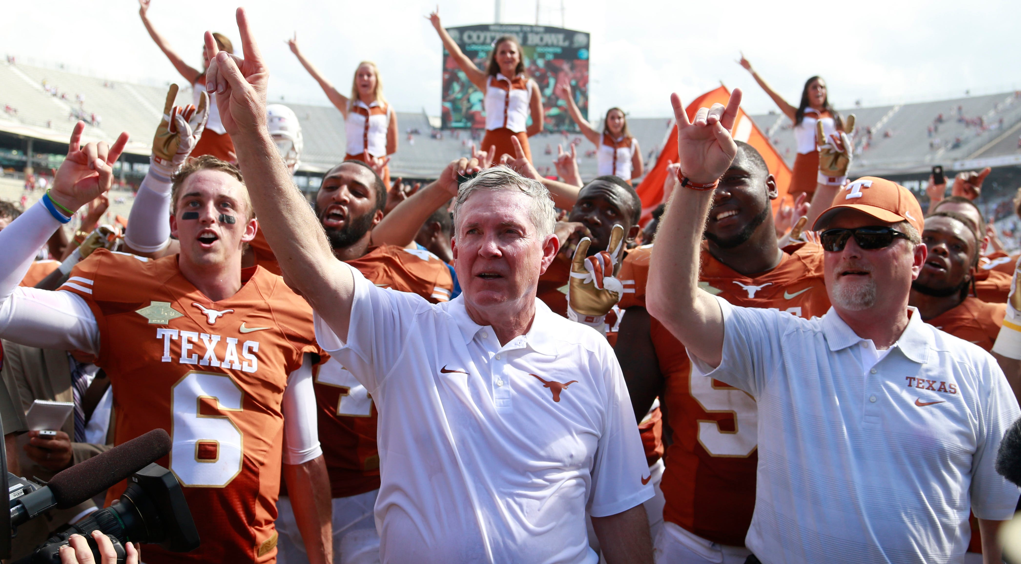 Texas coach Mack Brown celebrates winning his team beat Oklahoma in 2013.