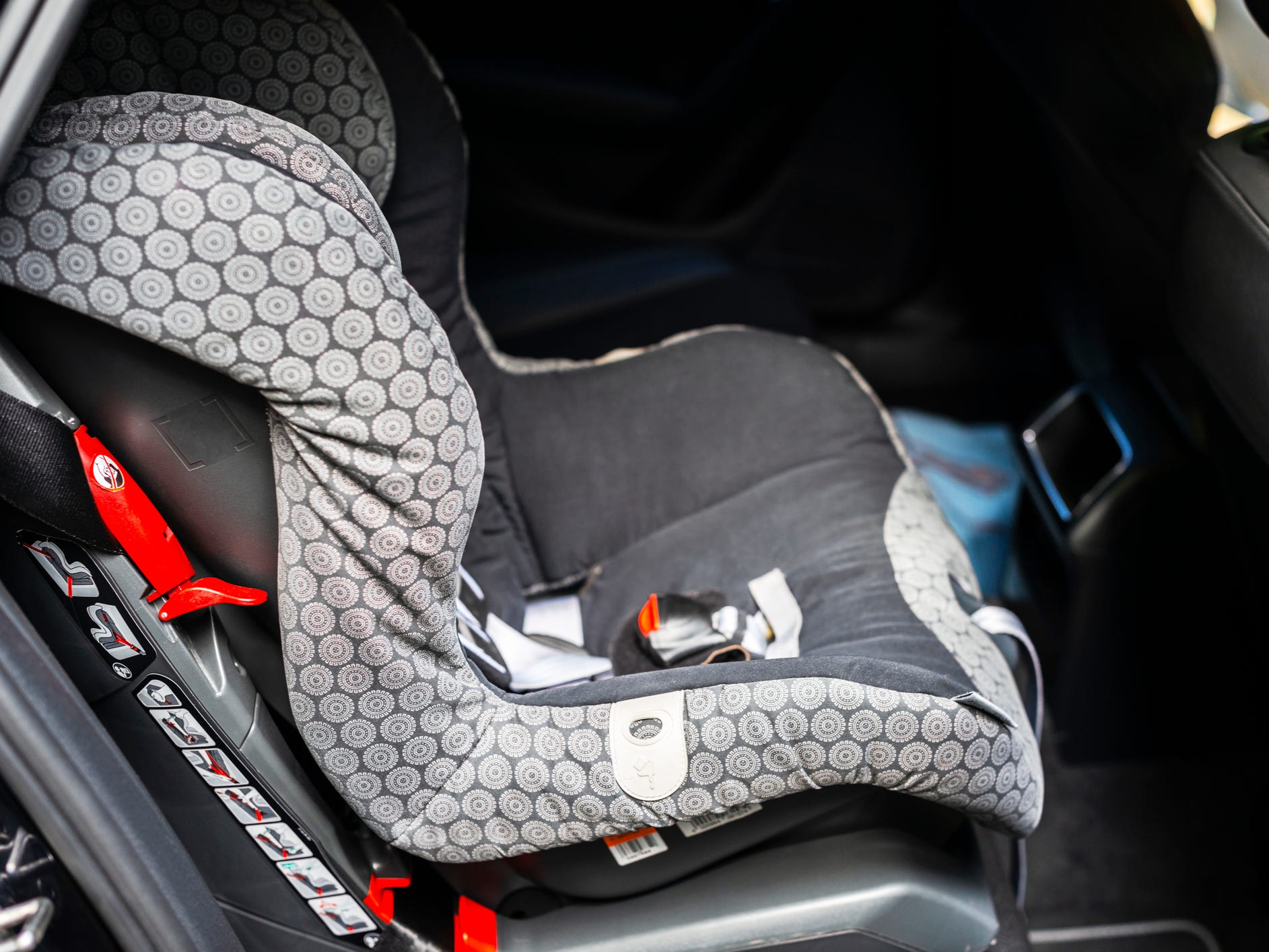 Child safety seat in the back of the car. Baby car seat for safety. Car interior. Car detailing