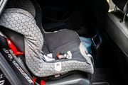 Child safety seat in the back of a car.