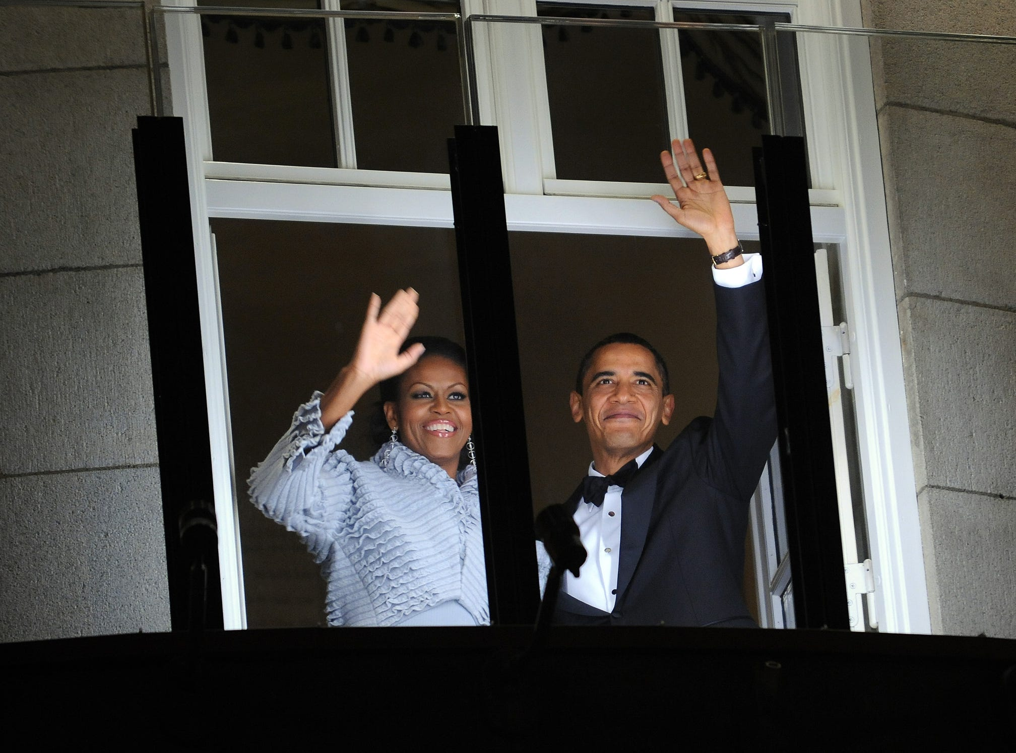 Nobel Peace Prize laureate, US President Barack Obama (R) and First Lady Michelle Obama greet the torch parade from the balcony of the Grand Hotel in Oslo on December 10, 2009. US President Barack Obama today accepted the Nobel Peace Prize, uncomfortably acknowledging his role as a leader at war while insisting that conflict can be morally justified.  AFP PHOTO/Jewel SAMAD (Photo credit should read JEWEL SAMAD/AFP/Getty Images)