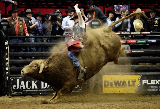 Bull rider Mason Lowe died on Tuesday after being injured at an event in Denver.