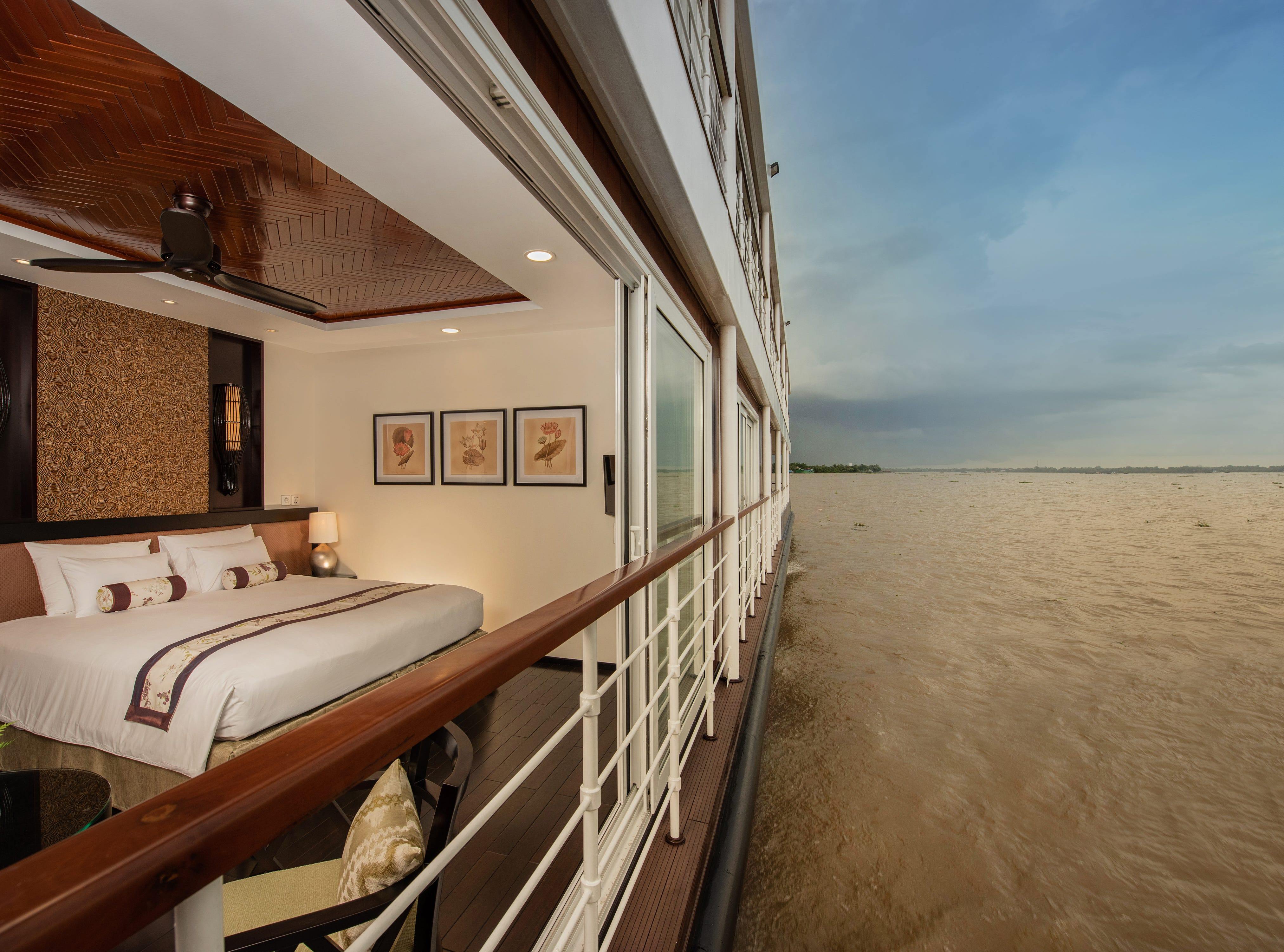 With the glass walls open, Avalon Saigon suites open up to the Mekong River like no other ship cabins on the waterway.