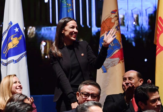 New York Rep. Alexandria Ocasio-Cortez attends a swearing-in ceremony and welcome reception for new Hispanic members of the U.S. Congress in Washington, D.C., on Jan. 9, 2019.