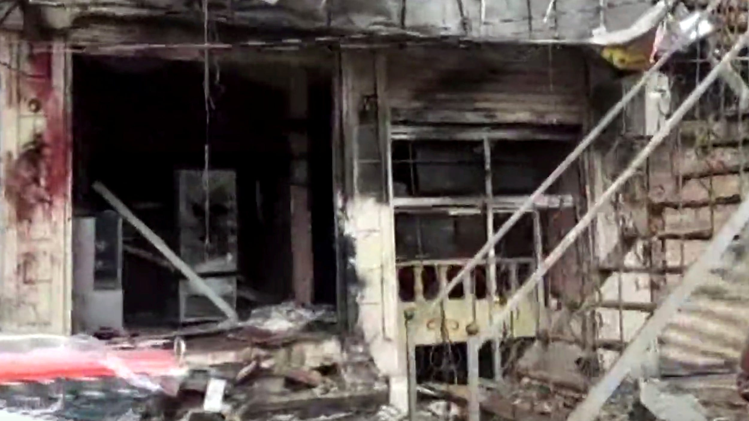 This frame grab from video provided by Hawar News, ANHA, the news agency for the semi-autonomous Kurdish areas in Syria, shows a damaged restaurant where an explosion occurred, in Manbij, Syria, Jan. 16, 2019. The Britain-based Syrian Observatory for Human Rights, a Syrian war monitoring group, and a local town council said Wednesday that the explosion took place near a patrol of the U.S.-led coalition and that there are casualties.
