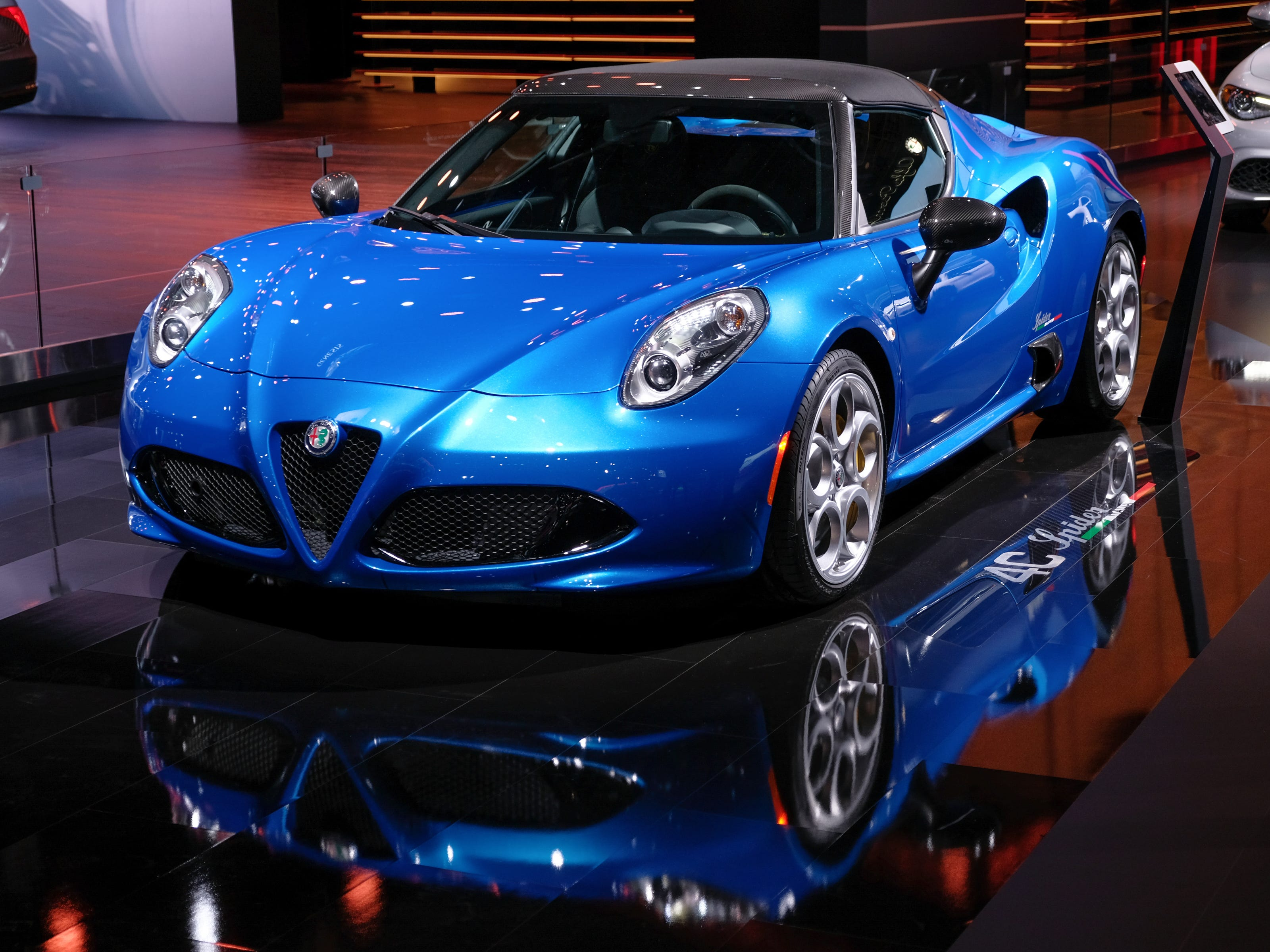 2019 Alfa Romeo 4C Spider is seen on the stage during the 2019 North American International Auto Show held at Cobo Center in downtown Detroit on Tuesday, Jan. 15, 2019.  (Via OlyDrop)