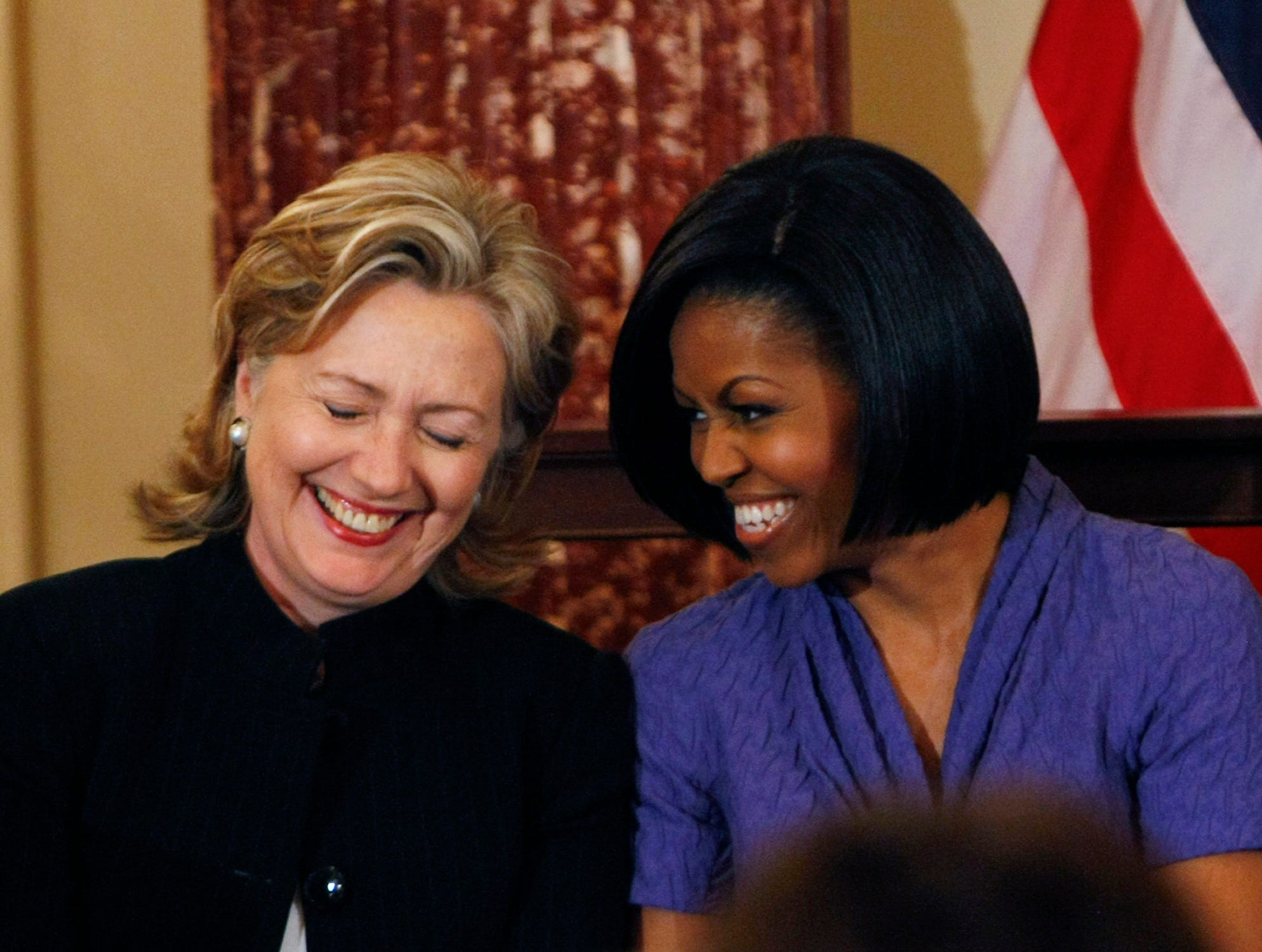 First lady Michelle Obama and Secretary of State Hillary Rodham Clinton share a laugh as they present the 2010 International Women of Courage Awards, Wednesday, March 10, 2010, at the State Department in Washington. (AP Photo/Gerald Herbert) ORG XMIT: DCGH108