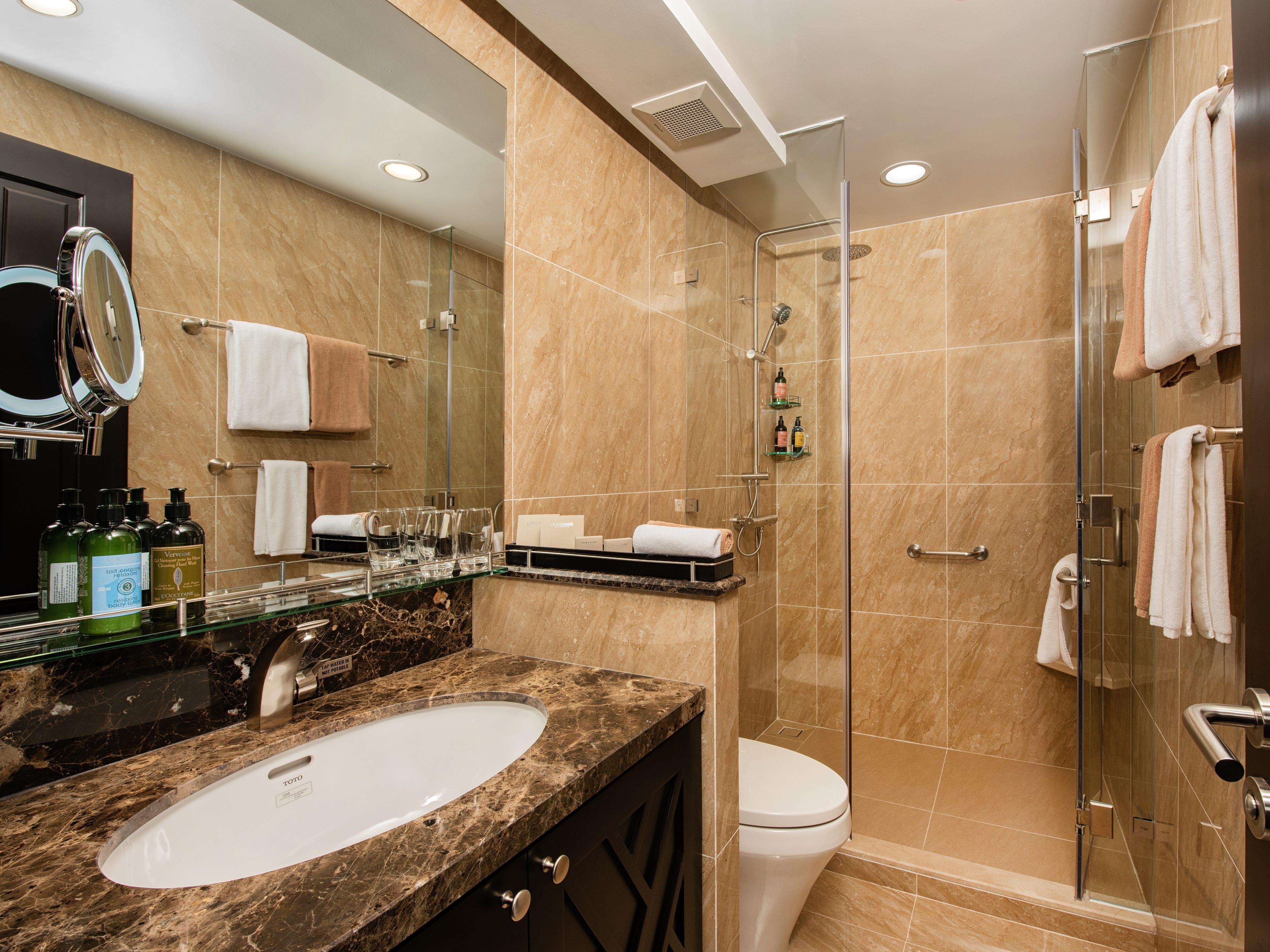 Avalon Saigon suites feature stylish, contemporary bathrooms.