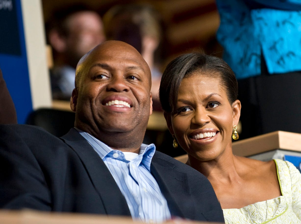Michelle Obama and her brother Craig Robinson attend the Democratic National Convention in Denver. (Photo by Rick Friedman/Corbis via Getty Images)