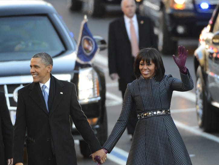 1/21/13 3:48:59 PM -- Washington, DC  -- President Barack Obama and First Lady Michelle Obama walk along Pennsylvania Ave during the Inaugural Parade. --    Photo by Andrew P. Scott, USA TODAY staff  ORG XMIT: AS 42934  1/21/2013  [Via MerlinFTP Drop]