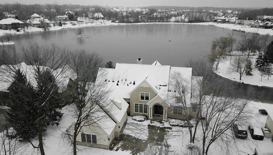 """This photo shows a home of Dr. William Husel in Dublin, Ohio, on Jan. 15, 2019. The intensive care doctor ordered """"significantly excessive and potentially fatal"""" doses of pain medicine for at least 27 near-death patients in the past few years after families asked that lifesaving measures be stopped, the Mount Carmel Health System announced after being sued by a family alleging an improper dose of fentanyl actively hastened the death of one of those patients."""