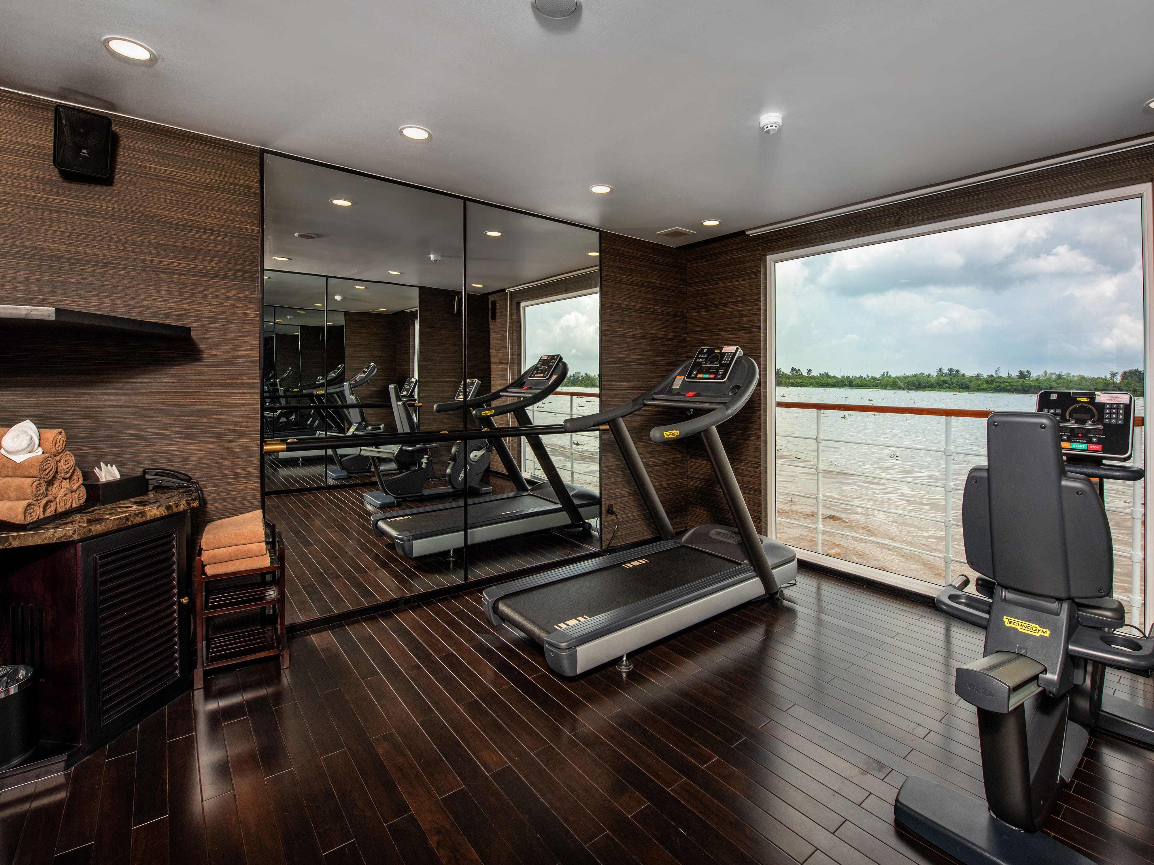 Avalon Saigon has a small fitness area with a floor-to-ceiling window offering views of the passing Mekong River.
