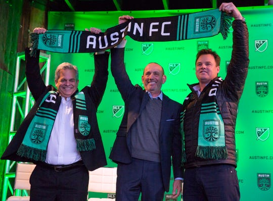 Austin mayor Steve Adler, MLS commissioner Don Garber and Austin FC chairman and CEO Anthony Precourt announce Austin FC as the newest MLS team at the Rustic Tap.